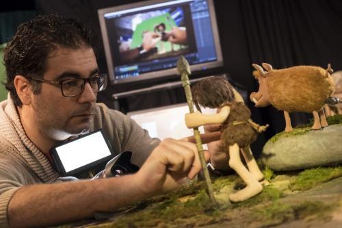 Early Man © STUDIOCANAL / Aardman Animations<br />Junior Animator Emanuel Nevado posing Dug for a production still.